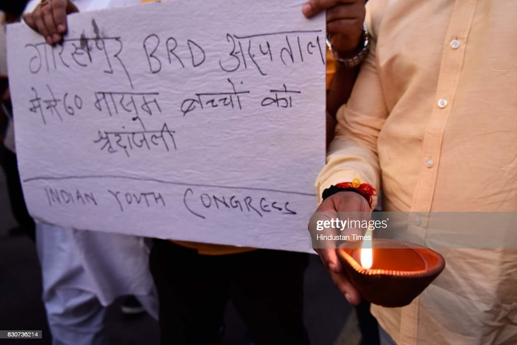 Indian Youth Congress members and activists hold a candlelight vigil in memories of the 30 children died in Gorakhpur hospital, outside Uttar Pradesh Chief Minister's residence, on August 12, 2017 in New Delhi, India. 30 children died since Thursday in Gorakhpur's Baba Raghav Das Medical College due to shortage of oxygen supply.