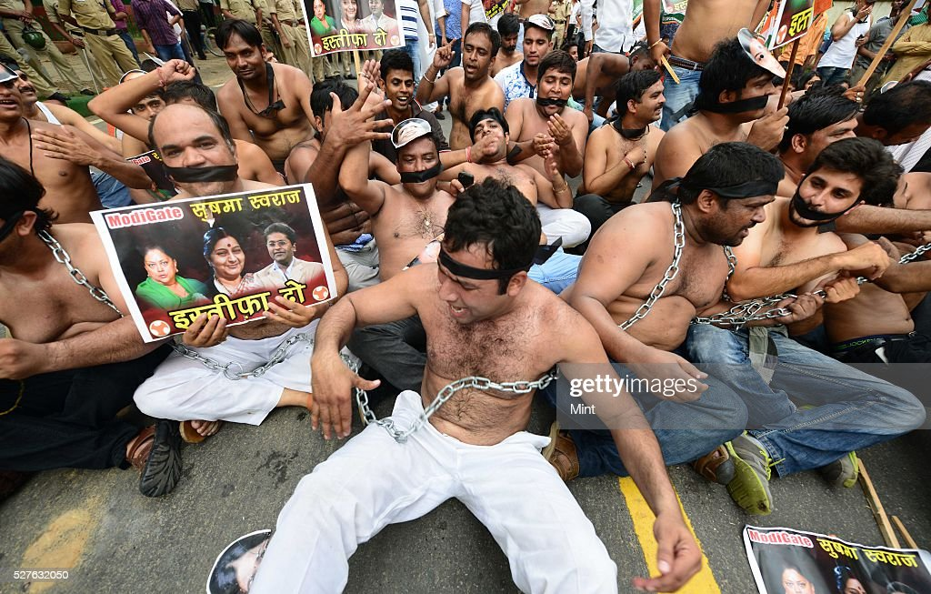 Indian youth congress workers in a shirtless protest against various scams of NDA government at Raisina road on August 6, 2015 in New Delhi, India.