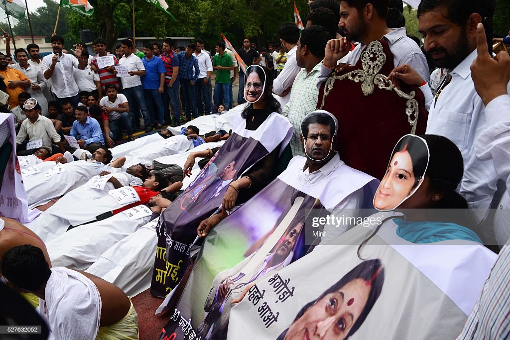 Indian youth congress workers staged a street play against various scams of NDA government at Raisina road on August 6, 2015 in New Delhi, India.