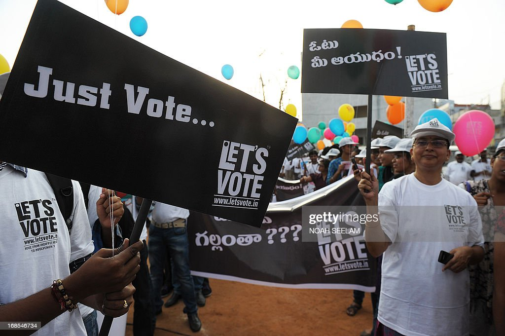 Indian youth hold placards during a 'Lets Vote' awareness campaign in Hyderabad on May 11, 2013. The Let's Vote campaign aims to raise awareness among urban youth to participate in the voting process gearing up for the general elections 2014. AFP PHOTO/Noah SEELAMl