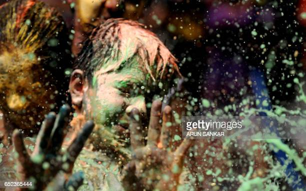 Indian youth play with colors during Holi celebrations in Chennai on March 12 2017 The Hindu festival of Holi or the 'Festival of Colours' heralds...