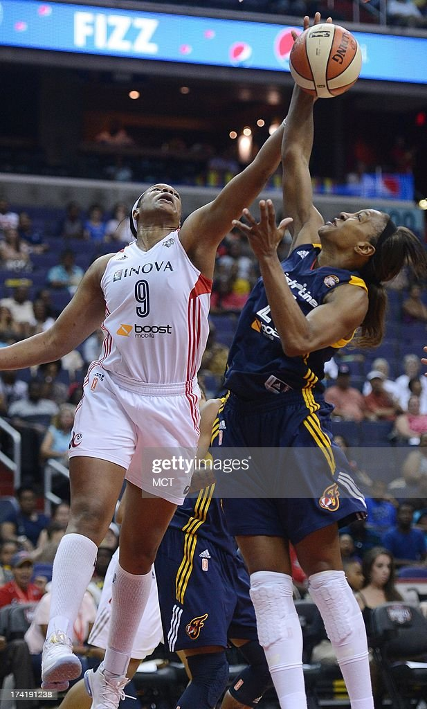 Indiana Fever forward Tamika Catchings (24), right, grabs a rebound against Washington Mystics center Kia Vaughn (9) in the fourth quarter at the Verizon Center in Washington, D.C., Sunday, July 21, 2013, The Fever defeated the Mystics, 65-52.