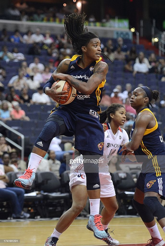 Indiana Fever guard Shavonte Zellous (1) pulls down a rebound against the Washington Mystics in the third quarter at the Verizon Center in Washington, D.C., Sunday, July 21, 2013, The Fever defeated the Mystics, 65-52.