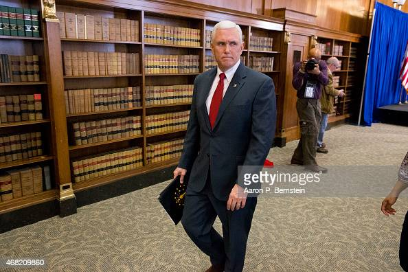 Indiana Gov Mike Pence leaves a press conference March 31 2015 at the Indiana State Library in Indianapolis Indiana Pence spoke about the state's...