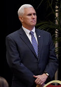 Indiana Gov Mike Pence waits as he is introduced before speaking during the Republican Jewish Coalition spring leadership meeting at The Venetian Las...