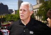 Indiana governor Mike Pence attends the 2014 IPL 500 Festival Parade during the 2014 Indy 500 Festival at on May 24 2014 in Indianapolis Indiana