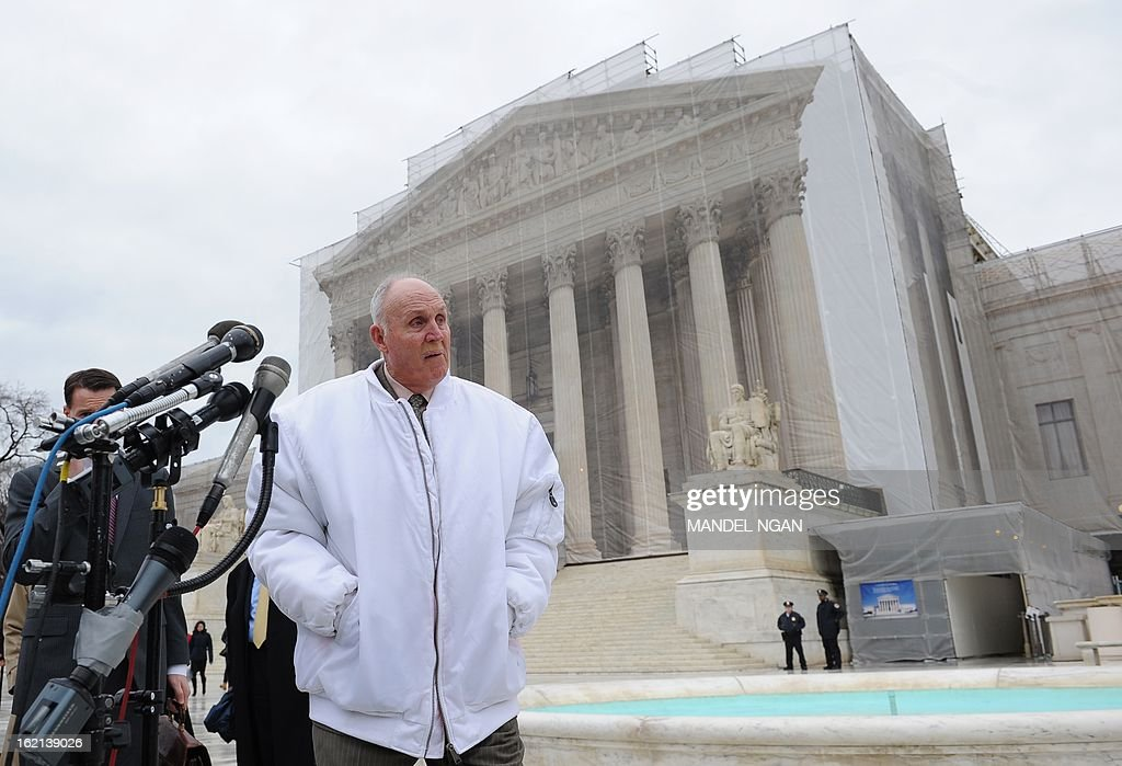 Indiana grain farmer Vernon Hugh Bowman walks up to microphones to speaks to reporters outside of the US Supreme Court on February 19, 2013 in Washington, DC. Bowman is at the Supreme Court appealing a lower court decision which ordered him to pay agri-bussiness giant Monsanto $84,000 USD for patent violation. AFP PHOTO/Mandel NGAN