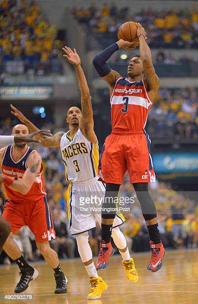 Indiana guard George Hill center cannot stop Washington guard Bradley Beal from hitting a shot at the top of the key as the Washington Wizards play...