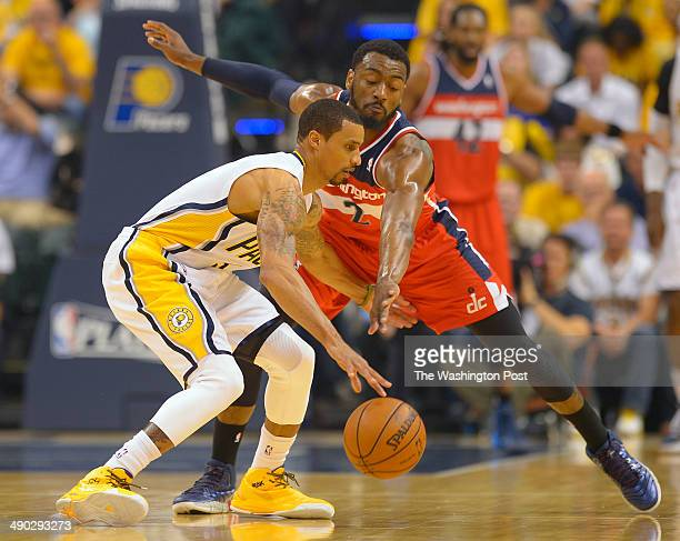 Indiana guard George Hill left is defended by Washington guard John Wall as the Washington Wizards play the Indiana Pacers in game five of the...