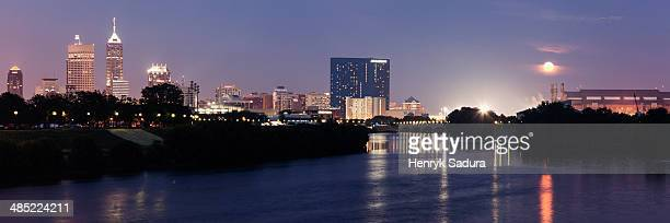 USA, Indiana, Indianapolis, Moon rising over city