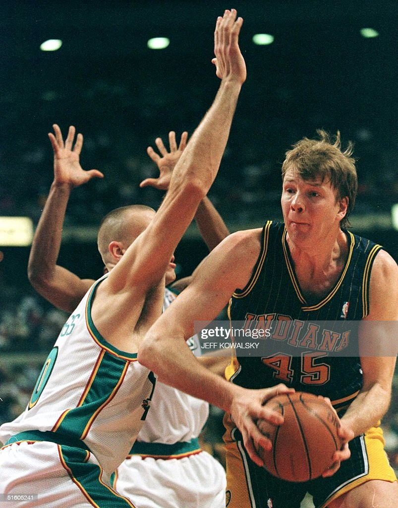 Indiana Pacer Rik Smits R drives around Detroit