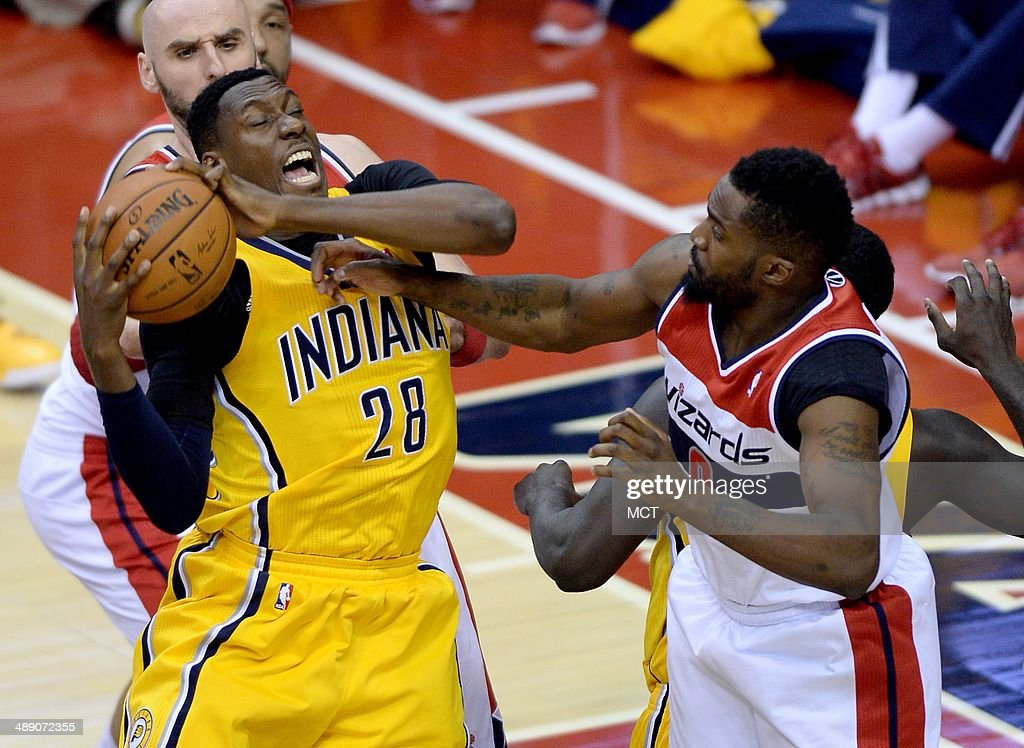 Indiana Pacers center Ian Mahinmi (28) battles for a rebound against Washington Wizards forward Martell Webster (9) and Wizards center Marcin Gortat (4), back left, in the third quarter of Game 3 of the NBA Eastern Conference semifinals at the Verizon Center in Washington, D.C., Friday, May 9, 2014. The Pacers defeated the Wizards, 85-63.