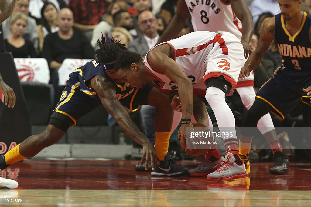 Indiana Pacers center Jordan Hill and Toronto Raptors guard DeMar DeRozan get mixed up when a loose ball happens int he key Toronto Raptors V Indiana...