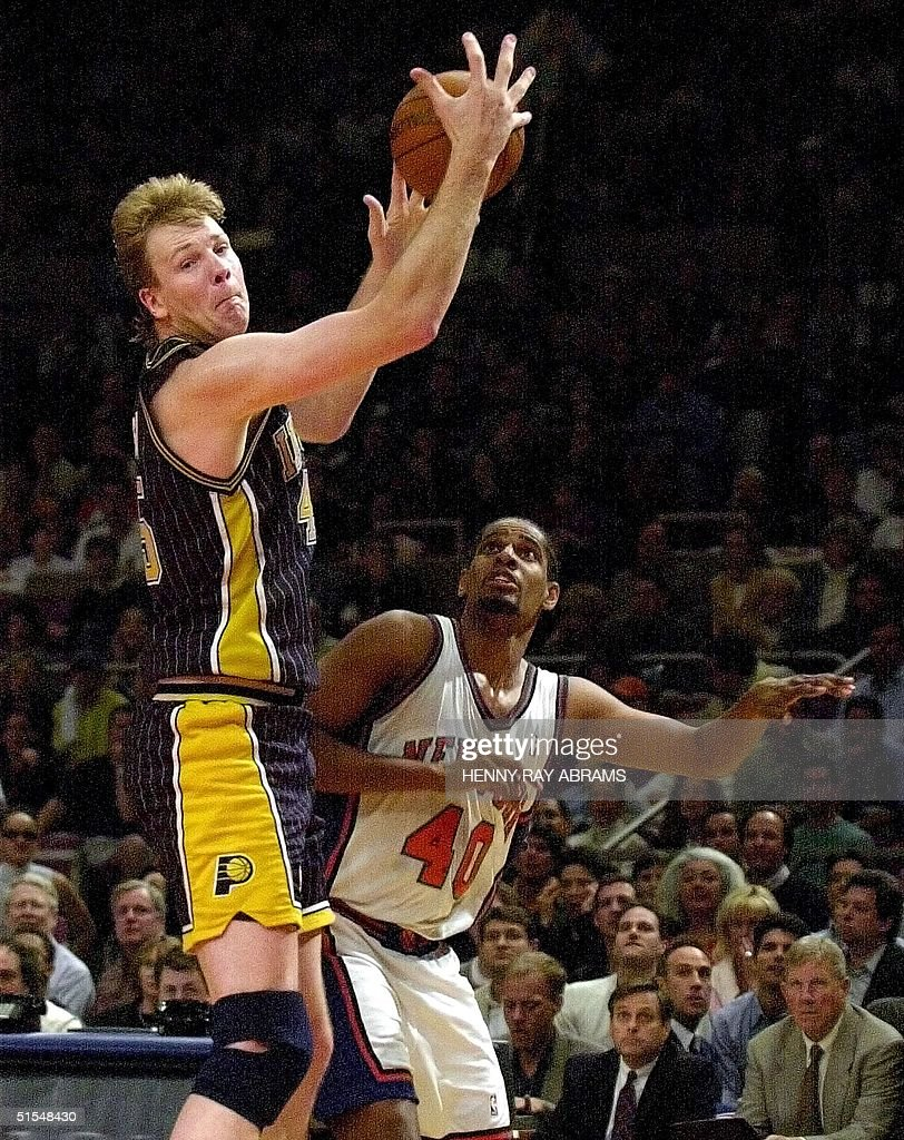 Indiana Pacers center Rik Smits L pulls a reboun
