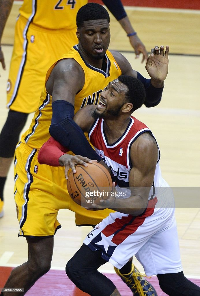 Indiana Pacers center Roy Hibbert (55) fouls Washington Wizards guard John Wall (2) in the fourth quarter of Game 3 of the NBA Eastern Conference semifinals at the Verizon Center in Washington, D.C., Friday, May 9, 2014. The Pacers defeated the Wizards, 85-63.