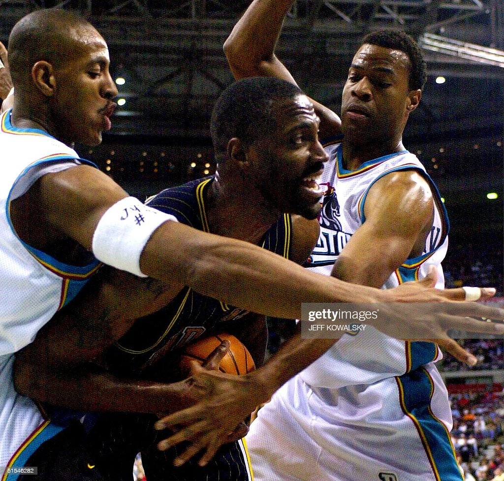 Indiana Pacers Dale Davis C is defended by Detro