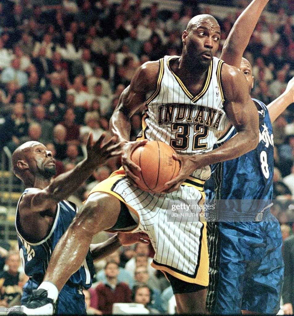 Indiana Pacers forward Dale Davis C grabs an of