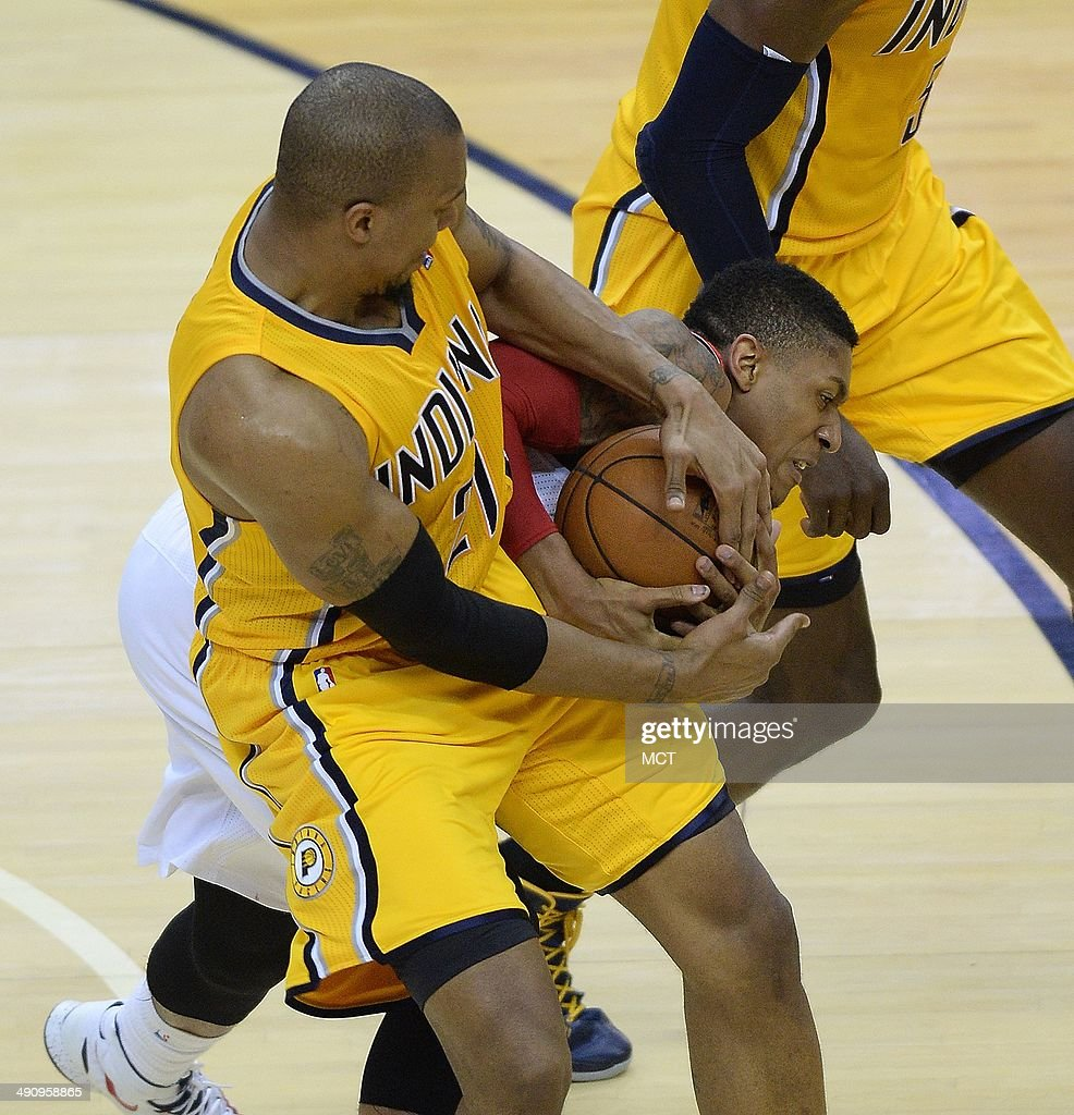Indiana Pacers forward David West and Washington Wizards guard Bradley Beal battle for the ball during the first half of Game 6 of the NBA Eastern...