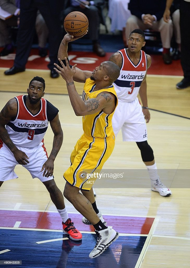Indiana Pacers forward David West shoots as Washington Wizards forward Martell Webster and guard Bradley Beal watch during the first half of Game 6...