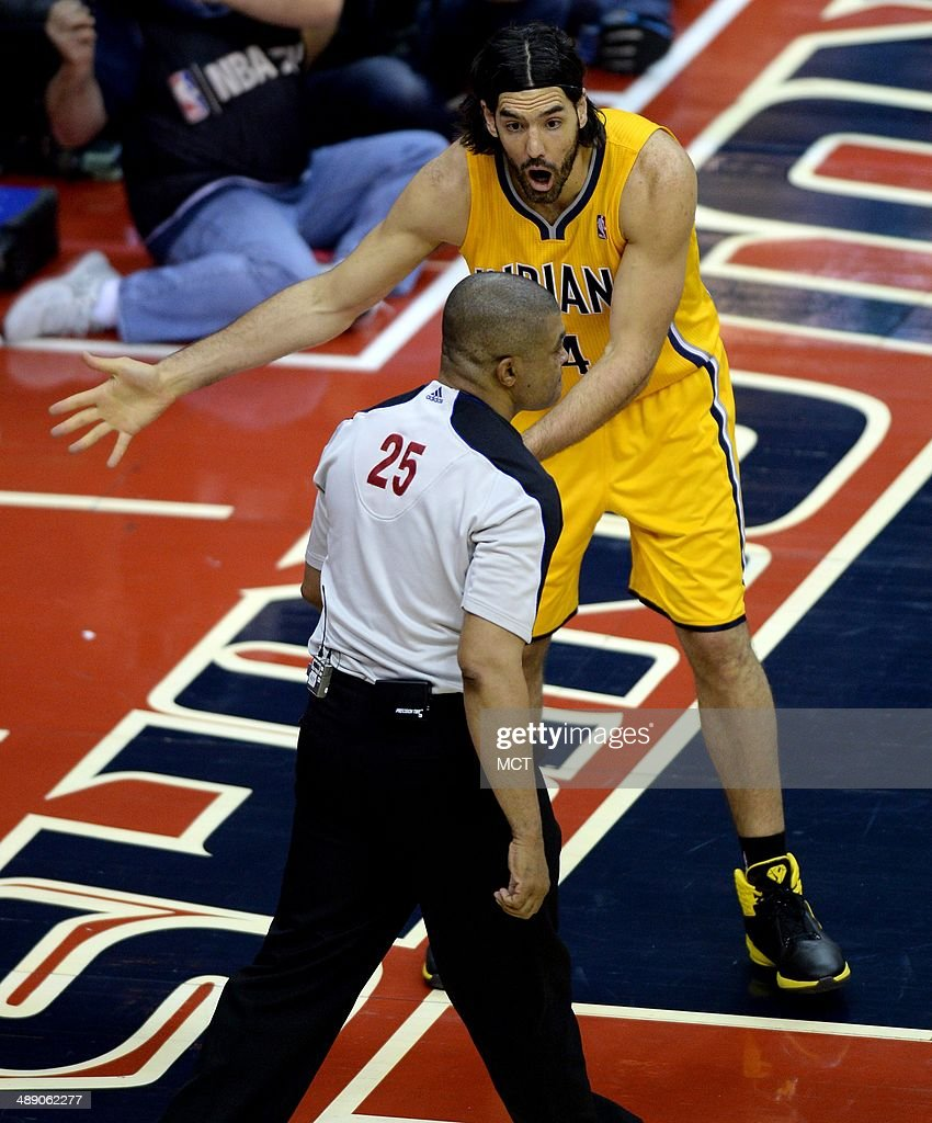 Indiana Pacers forward Luis Scola (4) disputes a technical foul call against him by referee Tony Brothers (25) in the first half against the Washington Wizards in Game 3 of the NBA Eastern Conference semifinals at the Verizon Center in Washington, D.C., Friday, May 9, 2014.