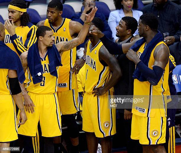 Indiana Pacers guard George Hill celebrates with Pacers center Roy Hibbert right near the end of an 8563 victory over the Washington Wizards in Game...