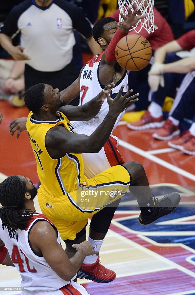 Indiana Pacers guard Lance Stephenson (1) scores and draws a foul on Washington Wizards guard John Wall (2) in the third quarter of Game 3 of the NBA Eastern Conference semifinals at the Verizon Center in Washington, D.C., Friday, May 9, 2014. The Pacers defeated the Wizards, 85-63.
