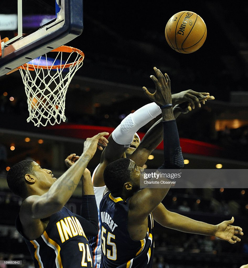 Indiana Pacers' Paul George (24), Roy Hibbert (55) and Charlotte Bobcats' Brendan Haywood (33) vie for a rebound during the second half at Time Warner Cable Arena on Wednesday, January 15, 2013, in Charlotte, North Carolina. The Pacers won 103-76.