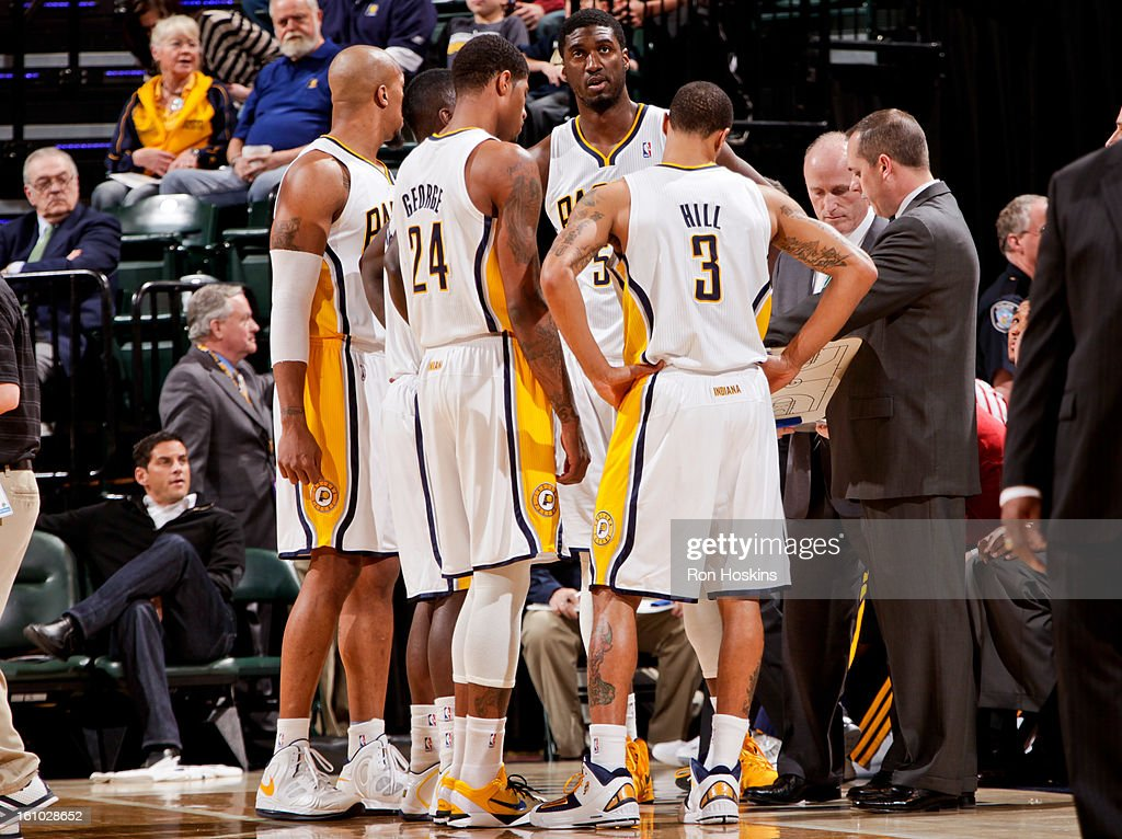 Indiana Pacers players, from left, David West #21, Paul George #24, Roy Hibbert #55 and George Hill #3 speak with head coach Frank Vogel during a game against the Toronto Raptors on February 8, 2013 at Bankers Life Fieldhouse in Indianapolis, Indiana.