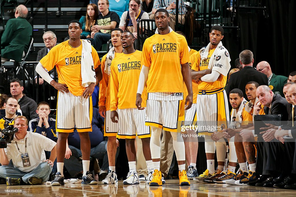 Indiana Pacers players, from left, Ian Mahinmi #28, Gerald Green #25, Lance Stephenson #1, Roy Hibbert #55 and Paul George #24 look on from the sideline during a game against the Milwaukee Bucks on March 22, 2013 at Bankers Life Fieldhouse in Indianapolis, Indiana.