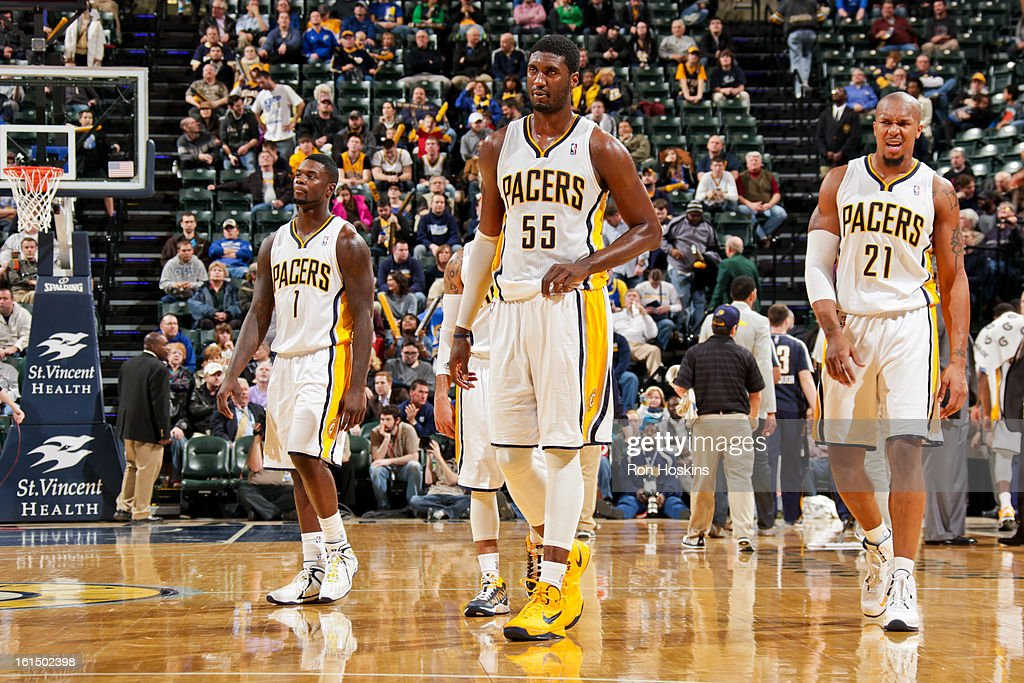 Indiana Pacers players, from left, Lance Stephenson #1, Roy Hibbert #55, and David West #21 wait to resume action against the Brooklyn Nets on February 11, 2013 at Bankers Life Fieldhouse in Indianapolis, Indiana.