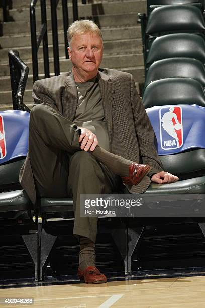 Indiana Pacers President Larry Bird looks on against the Orlando Magic during a preseason game on October 8 2015 at Bankers Life Fieldhouse in...