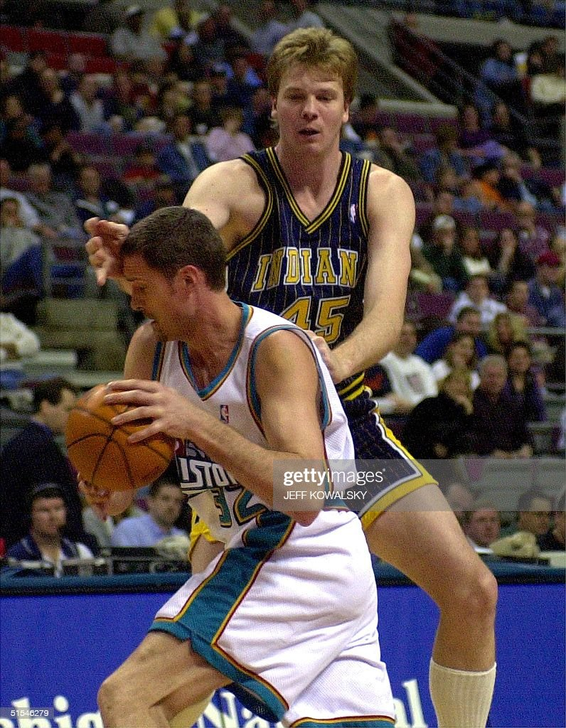 Indiana Pacers Rik Smits R defends Detroit Pisto