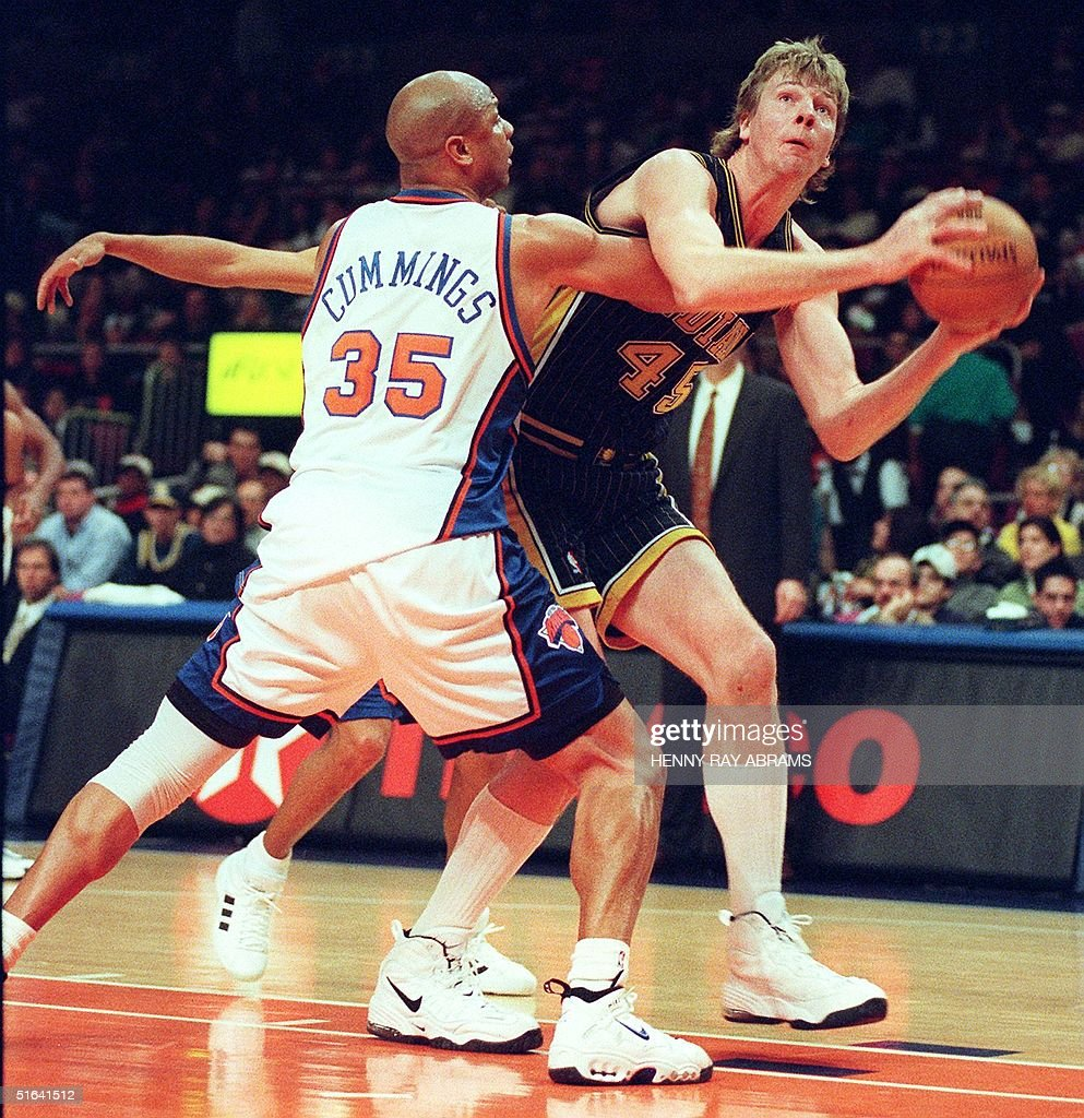 Indiana Pacer s Rik Smits R tries to shoot the b