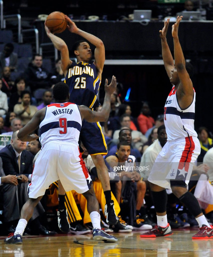 Indiana Pacers small forward Gerald Green (25) comes under pressure from Washington Wizards small forward Martell Webster (9) and Wizards power forward Kevin Seraphin (13) in the second half at the Verizon Center in Washington, D.C., Saturday, April 6, 2013. The Wizards beat the Pacers, 104-85.