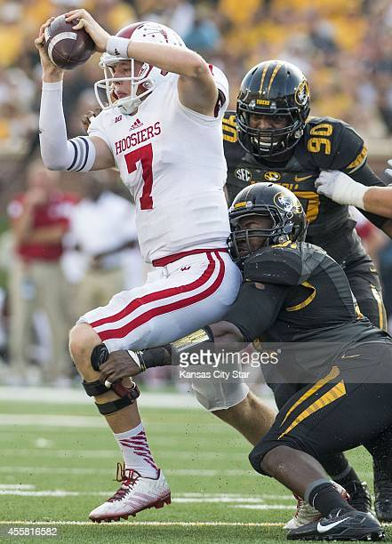Indiana quarterback Nate Sudfeld tries to get away from Missouri defensive linemen Charles Harris and Harold Brantley as he is sacked in the fourth...