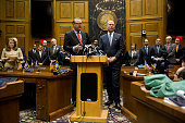 Indiana Senate President Pro Tem David Long speaks as House Speaker Brian Bosma looks on during a press conference about antidiscrimination...