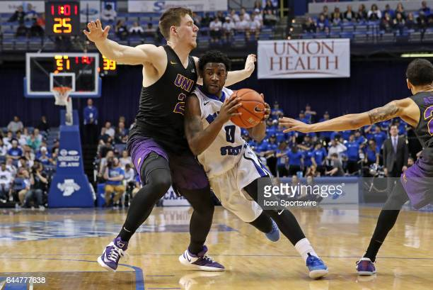 Indiana State Sycamores guard Everett Clemons leans into Northern Iowa Panthers forward Klint Carlson during the Missouri Valley Conference game on...