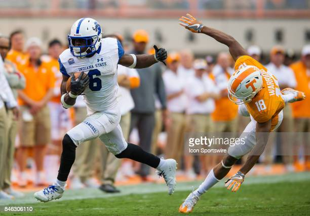 Indiana State Sycamores running back Lemonte Booker runs away from Tennessee Volunteers defensive back Nigel Warrior during a game between the...