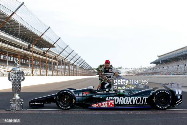 Indianapolis 500 Champion Tony Kanaan of Brazil driver of the Hydroxycut KV Racing TechnologySH Racing Chevrolet poses with his winning car and the...