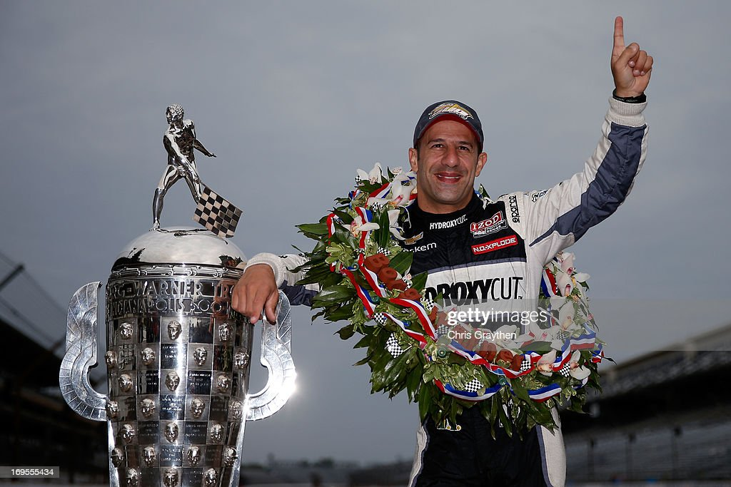 Indianapolis 500 Champion <a gi-track='captionPersonalityLinkClicked' href=/galleries/search?phrase=Tony+Kanaan&family=editorial&specificpeople=171962 ng-click='$event.stopPropagation()'>Tony Kanaan</a> of Brazil, driver of the Hydroxycut KV Racing Technology-SH Racing Chevrolet, poses with the Borg Warner Trophy at the yard of bricks during the Indianapolis 500 Mile Race Trophy Presentation and Champions Portrait Session at Indianapolis Motor Speedway on May 27, 2013 in Indianapolis, Indiana. Kanaan earned his first Indy 500 victory by winning the 97th running of the race.