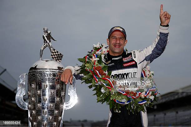Indianapolis 500 Champion Tony Kanaan of Brazil driver of the Hydroxycut KV Racing TechnologySH Racing Chevrolet poses with the Borg Warner Trophy at...
