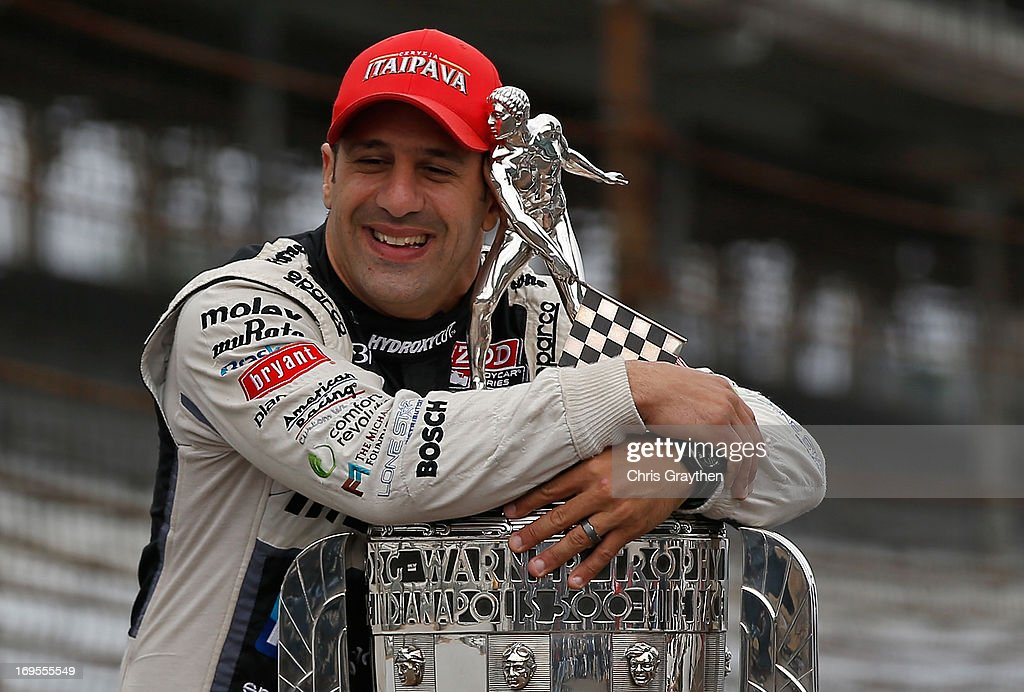 Indianapolis 500 Champion <a gi-track='captionPersonalityLinkClicked' href=/galleries/search?phrase=Tony+Kanaan&family=editorial&specificpeople=171962 ng-click='$event.stopPropagation()'>Tony Kanaan</a> of Brazil, driver of the Hydroxycut KV Racing Technology-SH Racing Chevrolet, hugs the Borg Warner Trophy at the yard of bricks during the Indianapolis 500 Mile Race Trophy Presentation and Champions Portrait Session at Indianapolis Motor Speedway on May 27, 2013 in Indianapolis, Indiana. Kanaan earned his first Indy 500 victory by winning the 97th running of the race.