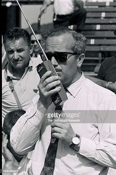Indianapolis 500 Lotus founder Colin Chapman stands in pit lane talking on a 2way radio