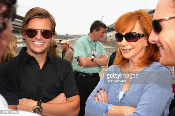 Indianapolis 500 winner Dan Wheldon and Reba McEntire arrive for the Brickyard 400 Qualifying presented by BigMachineRecordscom on July 30 2011 in...
