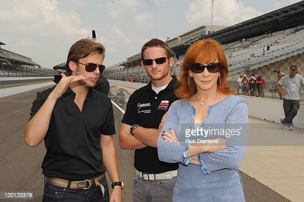 2011 Indianapolis 500 winner Dan Wheldon GrandAm Continental Tire Challenge driver Shelby Blackstock and Reba McEntire arrive for the Brickyard 400...