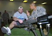 Indianapolis Colts center Jeff Saturday visits a target range at Schofield Barracks home of the US Army 25th Infantry February 7 2006 after practice...