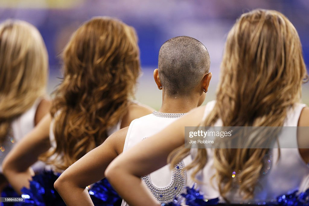 Indianapolis Colts cheerleader Crystal Ann stands with the rest of the squad after having her head shaved in support of head coach Chuck Pagano during the game against the Buffalo Bills at Lucas Oil Stadium on November 25, 2012 in Indianapolis, Indiana. The Colts won 20-13.