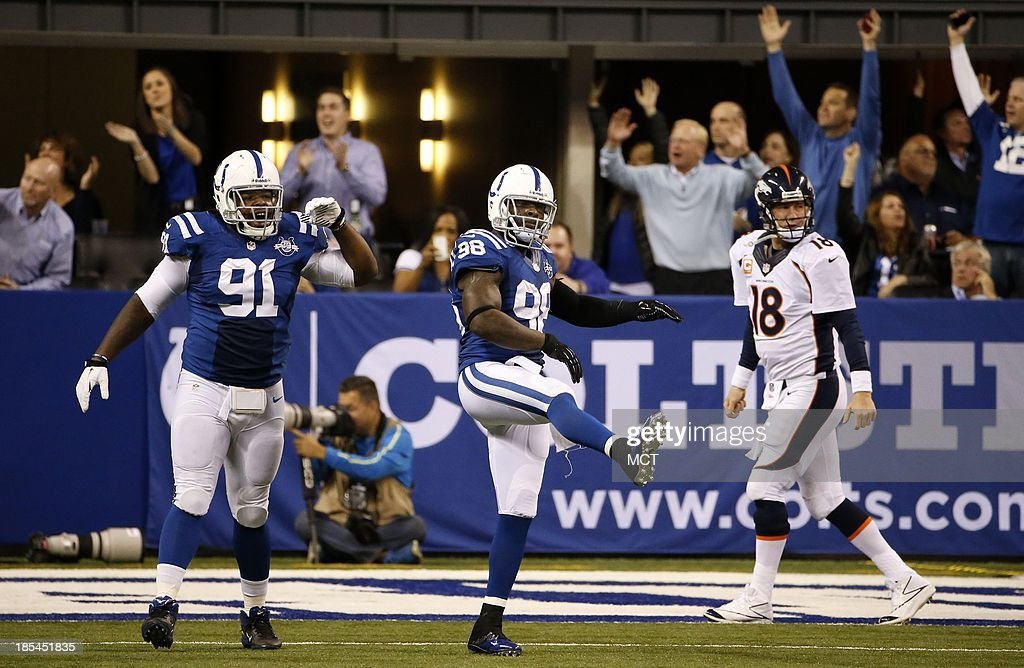 Indianapolis Colts defensive tackle Ricardo Mathews and Indianapolis Colts outside linebacker Robert Mathis celebrate after a play against Denver...