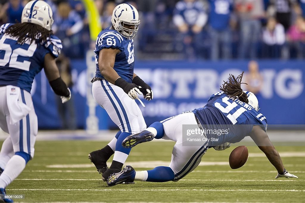 Indianapolis Colts defensive tackle Ricardo Mathews tries to pick up a fumble from Kansas City Chiefs quarterback Alex Smith in the third quarter of...