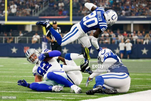 Indianapolis Colts free safety Darius Butler leaps over Dallas Cowboys tight end Jason Witten during the NFL preseason game between the Indianapolis...